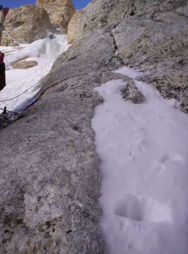 A climber negotiates an ice bulge in the Stettner Couloir.