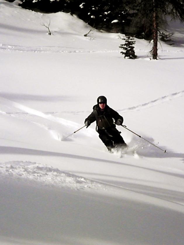 Evan Johnson skiing some low angle pow